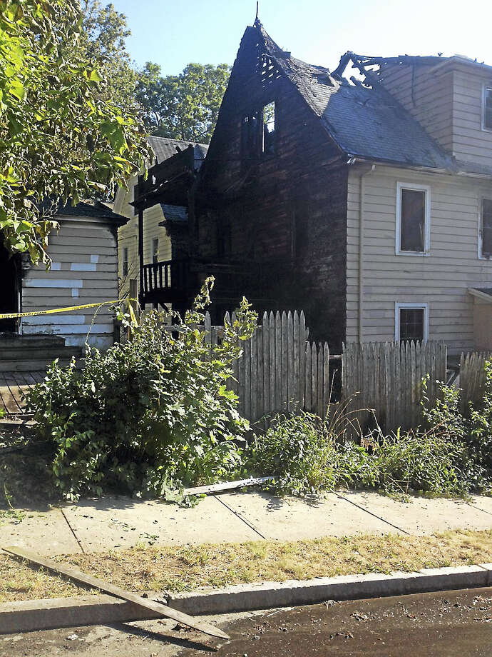 Three-family home at 1573 Ella Grasso Bvld. in New Haven is heavily damaged due to a fire Friday afternoon. Photo: Mary O'leary — New Haven Register