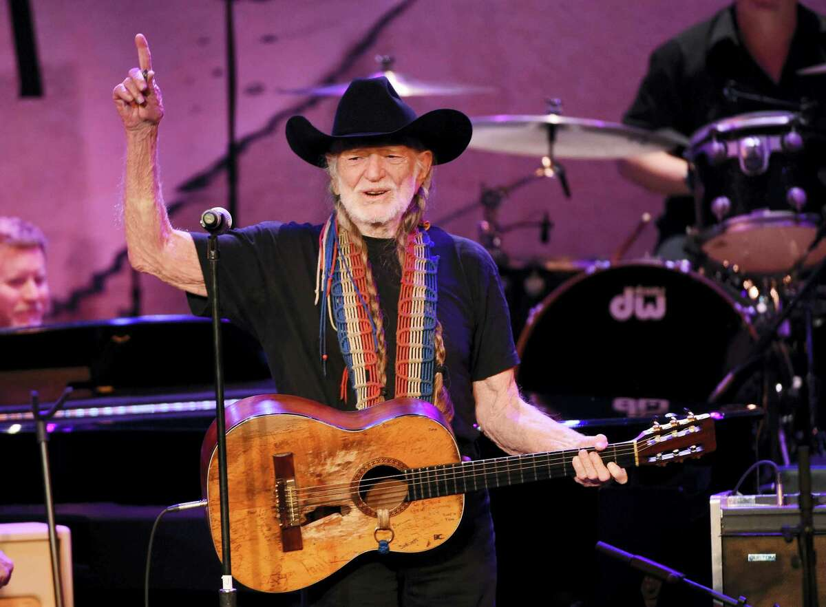 FILE - In this Feb. 5, 2015 file photo, Willie Nelson performs at the 17th Annual GRAMMY Foundation Legacy Concert at the Wilshire Ebell Theatre in Los Angeles. Cafe Nine will hold a Willie Nelson Songbook Celebration Saturday, May 29, 2016.