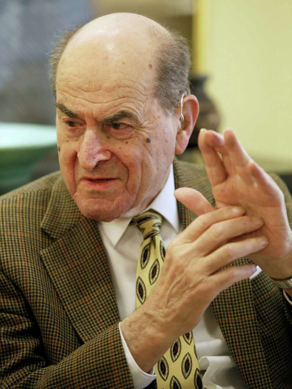 In this Feb. 5, 2014, file photo, Dr. Henry Heimlich describes the maneuver he developed to help clear obstructions from the windpipes of choking victims, while being interviewed at his home in Cincinnati. Heimlich recently used the emergency technique for the first time himself to save a woman choking on food at his senior living center. Heimlich said Thursday, May 26, 2016, that he has demonstrated the well-known maneuver many times through the years but had never before used it on a person who was choking.