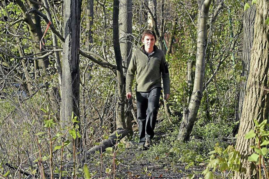 Trailblazer J.R. Logan hikes the Mill River Trail Wednesday, April 27, 2016, in New Haven. The Mill River Trail is one section of a larger trail system connecting Fair Haven to East Rock Park along the banks of the Mill River. Photo: Catherine Avalone — New Haven Register     / New Haven RegisterThe Middletown Press
