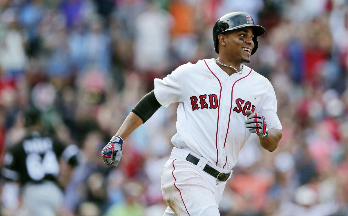 Boston Red Sox's Xander Bogaerts smiles as he heads down the line on his walkoff RBI-single during the 10th inning against the Chicago White Sox Thursday in Boston.