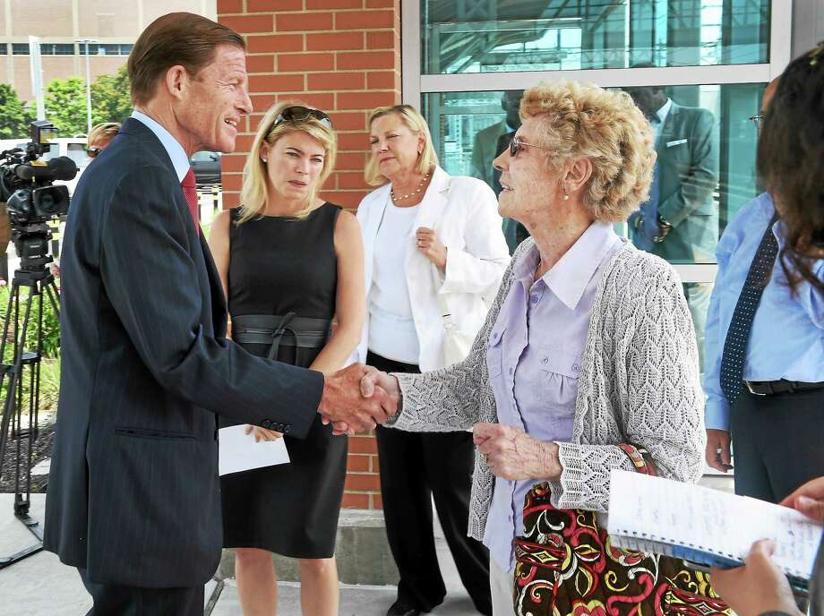 Annie Luden of East Haven, right, shakes hands with U.S. Sen. Richard Blumenthal, with Federal Railroad Administration Acting Administrator Sarah Feinberg, second from left, and Luden's daughter, Patricia Luden, before the start of a press conference July 6, 2015, addressing efforts to improve worker railroad worker safety. Luden's son, Robert E. Luden of East Haven, a railroad worker, was killed in a work-related accident in 2013. Photo: Peter Hvizdak — New Haven Register FILE PHOTO   / ©2015 Peter Hvizdak