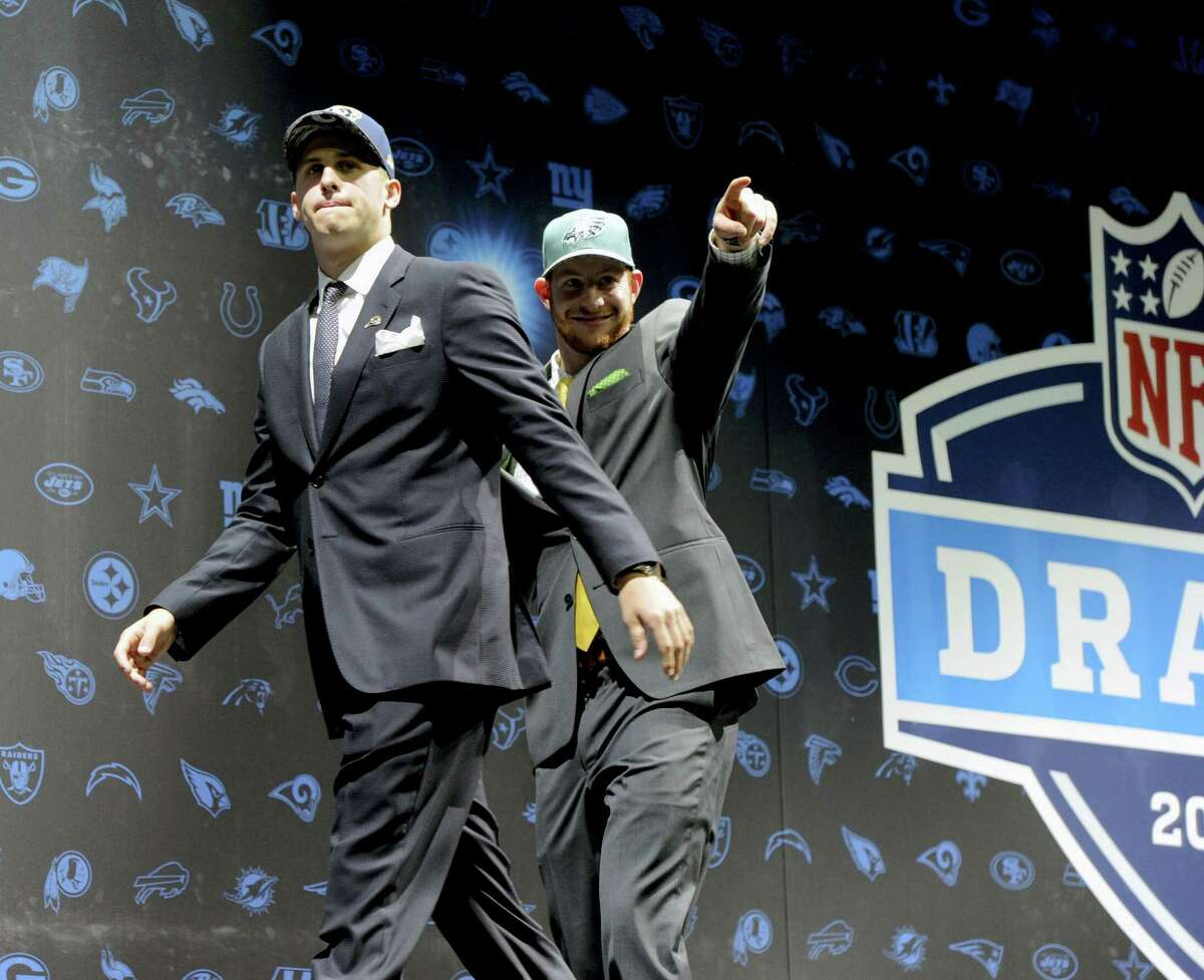 Jared Goff, left, after being selected by Los Angeles Rams as their number one pick and Carson Wentz, after being selected by the Philadelphia Eagles as their number two pick in the first round of the 2016 NFL football draft greet fans at Selection Square in Grant Park, Thursday, April 28, 2016, in Chicago. (AP Photo/Matt Marton)