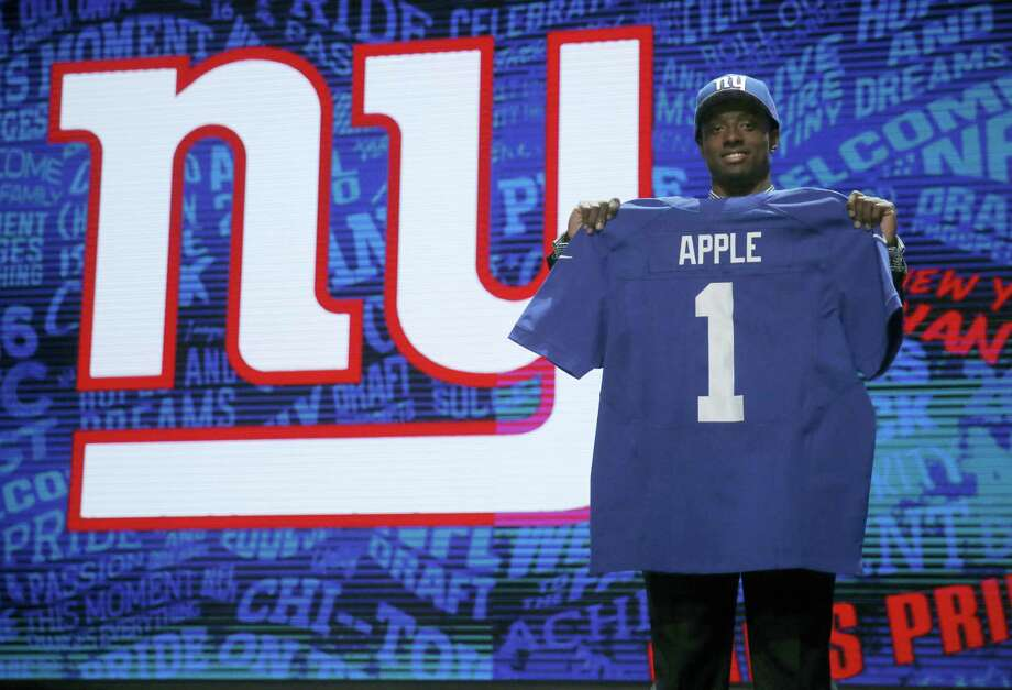 Ohio State's Eli Apple poses for photos after being selected by New York Giants as the 10th pick in the first round of the 2016 NFL football draft, Thursday, April 28, 2016, in Chicago. (AP Photo/Charles Rex Arbogast) Photo: AP / AP