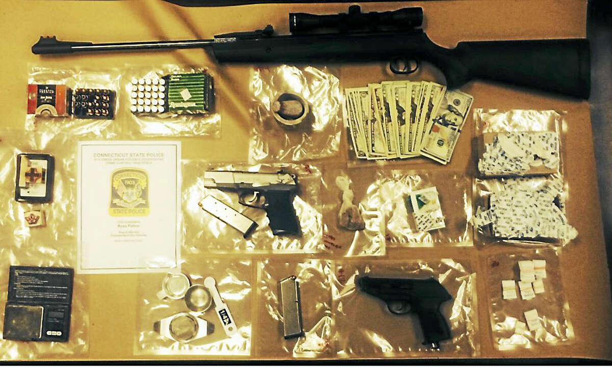A man was arrested Wednesday after authorities allegedly found heroin, cash and guns in his Branford condo.