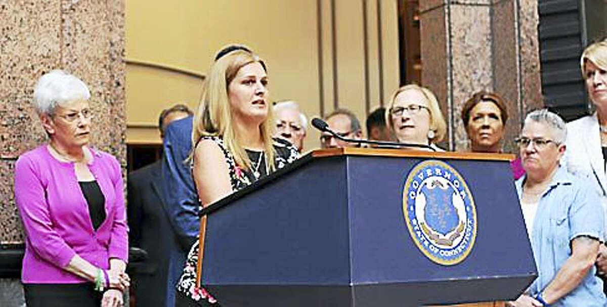Sue Kruczek of Guilford speaks at the podium