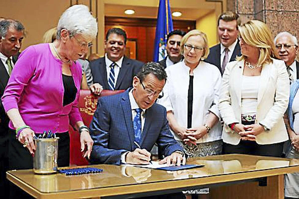 Gov. Dannel P. Malloy signs the bill Friday