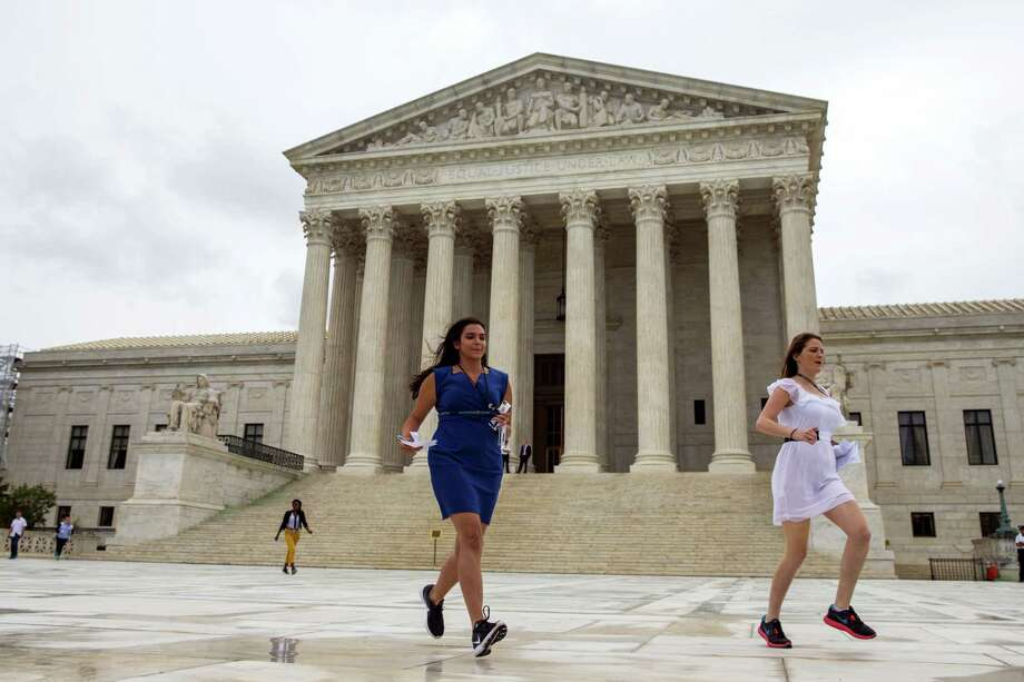 Members of the media run out of the Supreme Court in Washington, Thursday, June 23, 2016, to deliver court decisions. Photo: AP Photo/Evan Vucci   / Copyright 2016 The Associated Press. All rights reserved. This material may not be published, broadcast, rewritten or redistribu