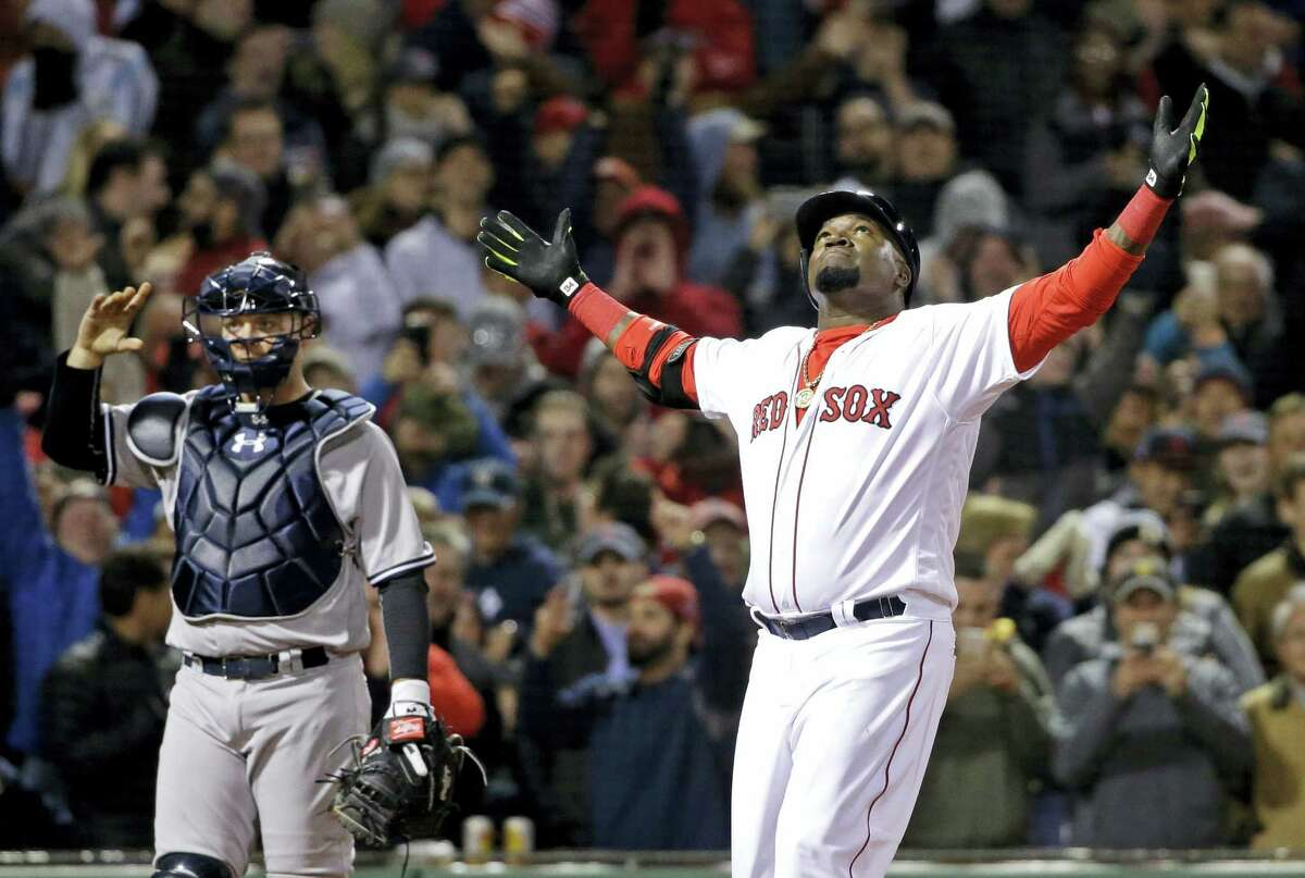 Red Sox designated hitter David Ortiz celebrates his two-run home run in the eighth inning against the Yankees on Friday at Fenway Park.