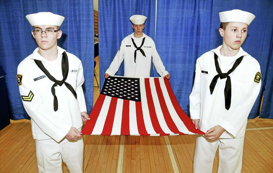 Left to right, U.S. Naval Sea Cadets Sean Lawlor, Roman Putnam and Kasey Beck prepare to carry the flag for folding at the closing ceremony of the Hamden Veterans Awareness Day at Quinnipiac University in Hamden Friday. Photo: Arnold Gold — New Haven Register