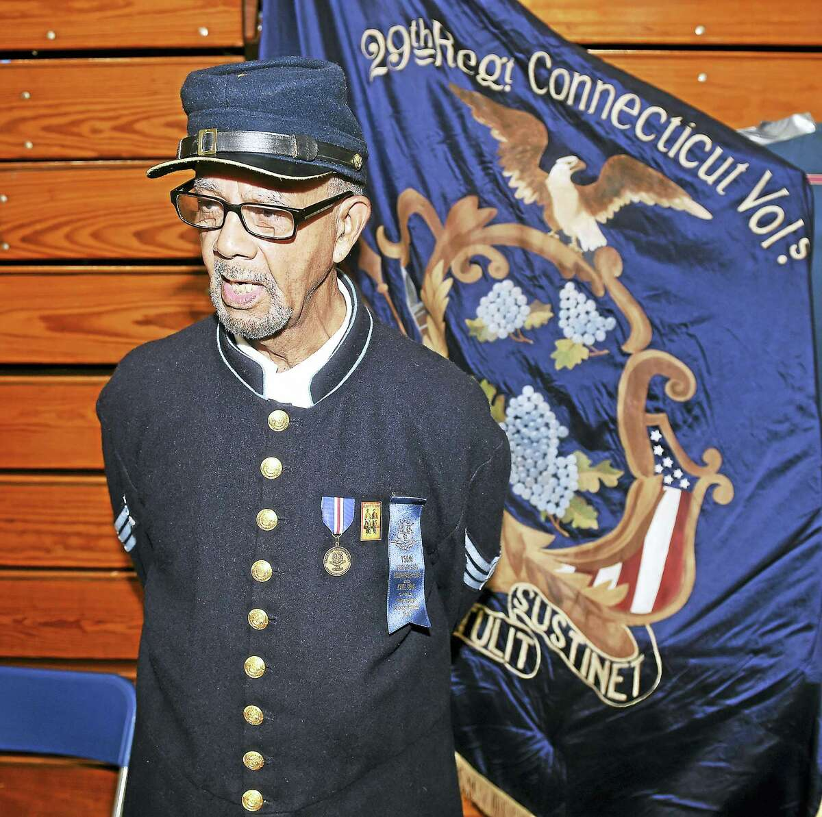 Dressed in a Civil War uniform, Raymond Sims, Sr., talks about the 29th Colored Connecticut Volunteers Infantry during the Hamden Veterans Awareness Day at Quinnipiac University in Hamden Friday.