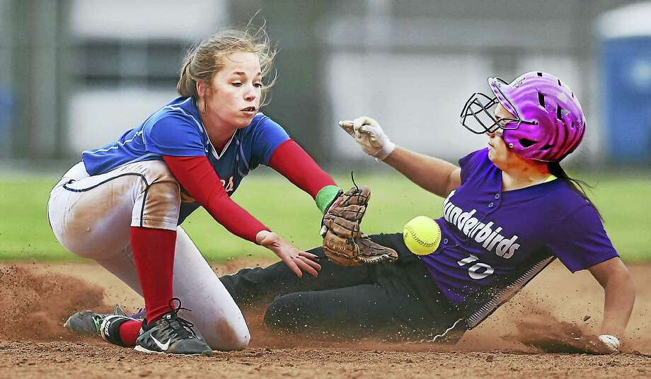 North Branford senior catcher Sabrina LeMere steals second as Hale-Ray freshman shortstop Angelina Ramada waits for the throw, in a 5-3 win Thursday for the Thunderbirds at Totoket Park in North Branford. Photo: Catherine Avalone — New Haven Register / New Haven RegisterThe Middletown Press