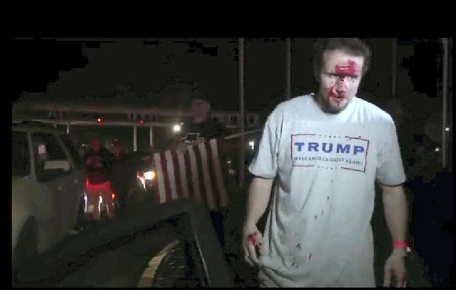 This still image taken from video shows a supporter of Republican presidential candidate Donald Trump after a protest on Thursday, April 28, 2016, in Costa Mesa, Calif.  Dozens of protesters were mostly peaceful Thursday as Trump gave his speech inside the Pacific Amphitheater. After the event, however, the demonstration grew rowdy late in the evening and spilled into the streets. Photo: APTN Via AP Photo    / (APTN via AP Photo)