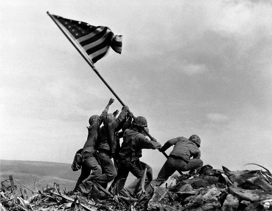 In this Feb 23, 1945 file photo, U.S. Marines of the 28th Regiment, 5th Division, raise the American flag atop Mt. Suribachi, Iwo Jima, Japan. The Marines Corps announced Thursday that one of the six men long identified in the iconic World War II photograph was actually not in the image. A panel found that Private First Class Harold Schultz, of Detroit, was in the photo and that Navy Pharmacist's Mate 2nd Class John Bradley wasn't in the image. Bradley had participated in an earlier flag-raising on Mount Suribachi. Photo: AP Photo — Joe Rosenthal, File / Copyright 2016 The Associated Press. All rights reserved. This material may not be published, broadcast, rewritten or redistribu