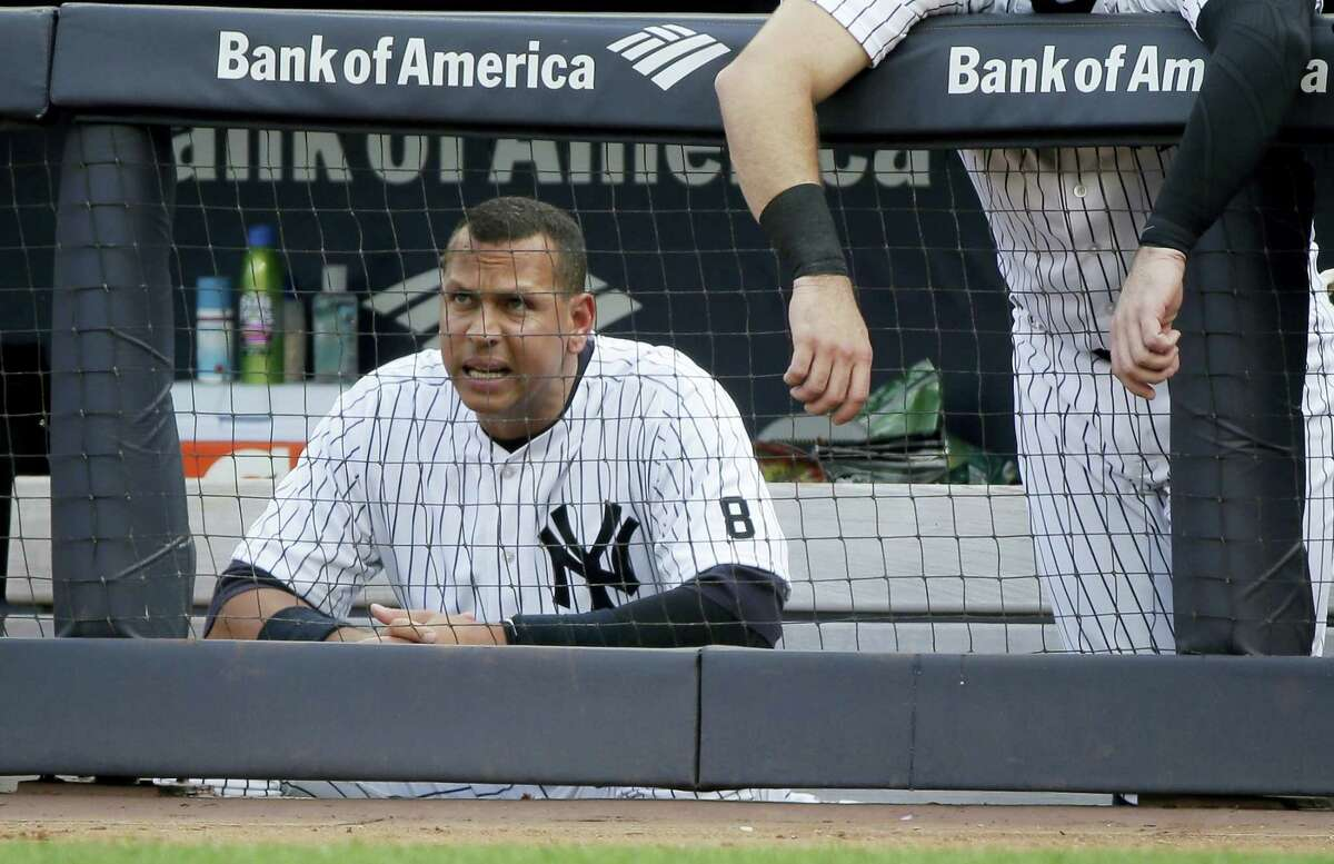 Yankees designated hitter Alex Rodriguez watches from the dugout during the eighth inning on Thursday.