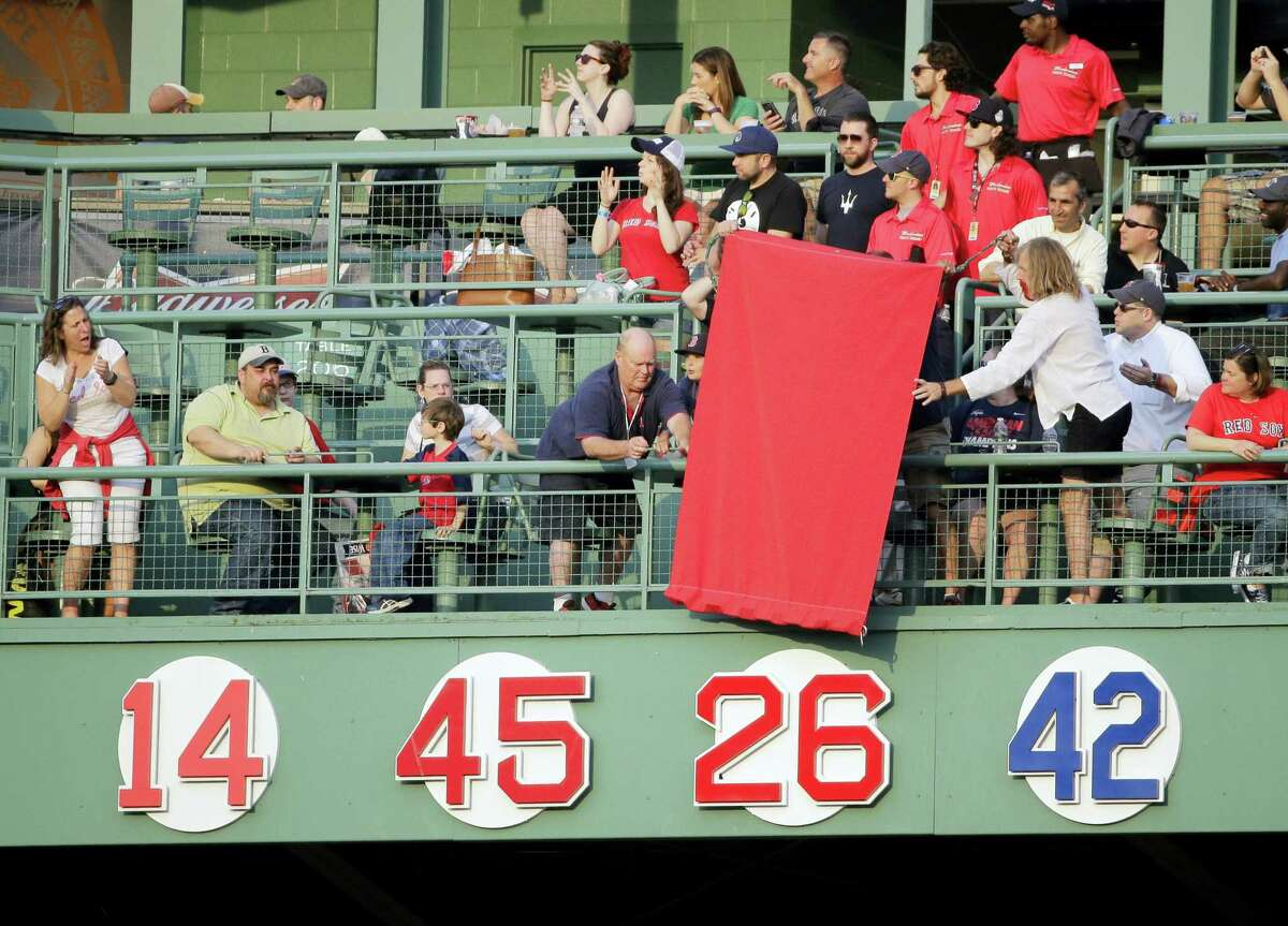 The No. 26 of former Red Sox player Wade Boggs is uncovered during the retirement ceremony on Thursday at Fenway Park.