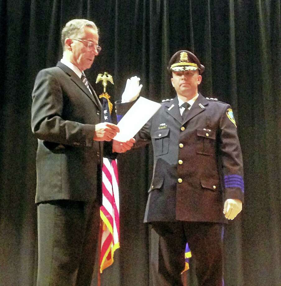 Mayor Joseph Maturo swears in Ed Lennon as chief of police of East Haven Thursday at the Joseph Melillo Middle School Auditorium. Photo: Juliemar Ortiz — New Haven Register
