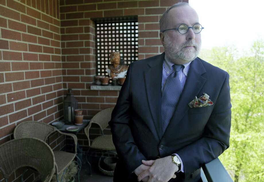 In this photo taken May 19, 2016, Kenneth P. Chrzastek poses for a photo at his home in Chicago. Taking Social Security benefits early comes with a price, yet more than 4 in 10 Americans who are 50 and over say they'll dip into the program before reaching full retirement age. Photo: AP Photo/M. Spencer Green   / Copyright 2016 The Associated Press. All rights reserved. This material may not be published, broadcast, rewritten or redistribu