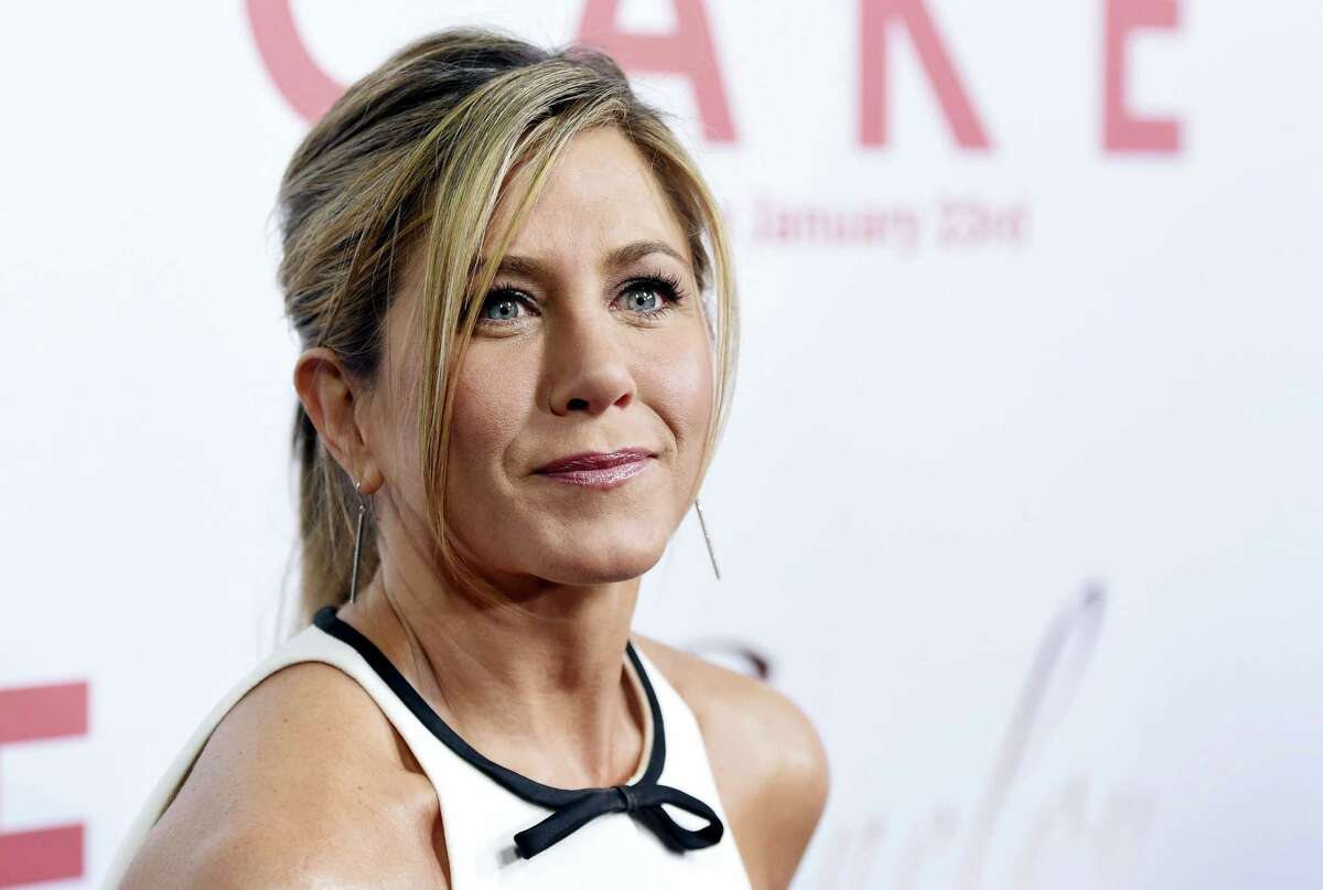 """In this Jan. 14, 2015, file photo, Jennifer Aniston, a cast member in """"Cake,"""" poses at the premiere of the film at Arclight Cinemas in Los Angeles. Aniston announced the death of her mother, Nancy Dow, in a statement to People magazine on May 25, 2016."""
