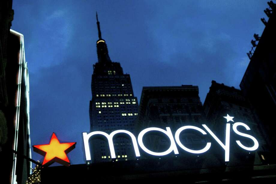 With the Empire State building in the background, the Macy's logo is illuminated on the front of the department store in New York. Photo: AP Photo/Mark Lennihan, File   / Copyright 2016 The Associated Press. All rights reserved. This material may not be published, broadcast, rewritten or redistribu