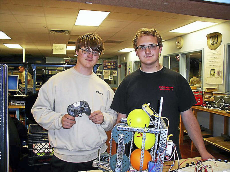 William Bassett, left, and his brother, Ben, won first place in Connecticut for their robot in the SkillsUSA competition and hope to move on to the national competition in June, along with another nine winners. The Platt students are trying to raise $10,000 for the trip. Photo: Contributed Photo