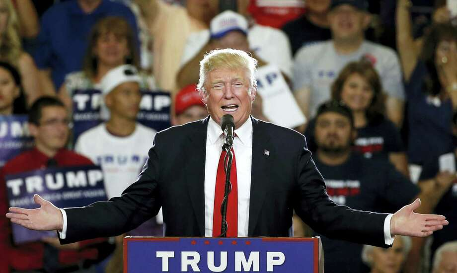 Republican presidential candidate Donald Trump speaks at a campaign event in Albuquerque, N.M. According to an AP count: Trump has reached the number of delegates needed to clinch the Republican nomination for president. Trump, the only remaining GOP candidate left in the race, will go on to accept the nomination at the party's national convention in Cleveland. Photo: AP Photo — Brennan Linsley, File    / Copyright 2016 The Associated Press. All rights reserved. This material may not be published, broadcast, rewritten or redistribu