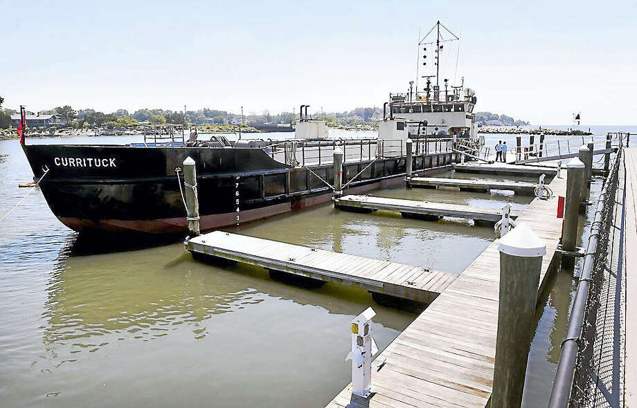 The Currituck docked Tuesday at the Milford Yacht Club. The Currituck is currently dredging Milford Harbor. Photo: Photo By Arnold Gold — New Haven Register