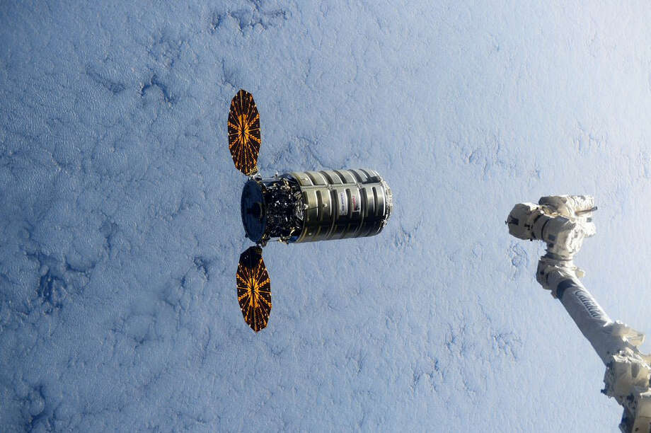 In this Dec. 9, 2016 photo made available by NASA via Twitter, a Cygnus spacecraft approaches the International Space Station. A similar Cygnus spacecraft is set to burn up over the Earth's atmosphere on Wednesday, June 22, 2016. Photo: Scott Kelly/NASA Via AP, File   / NASA
