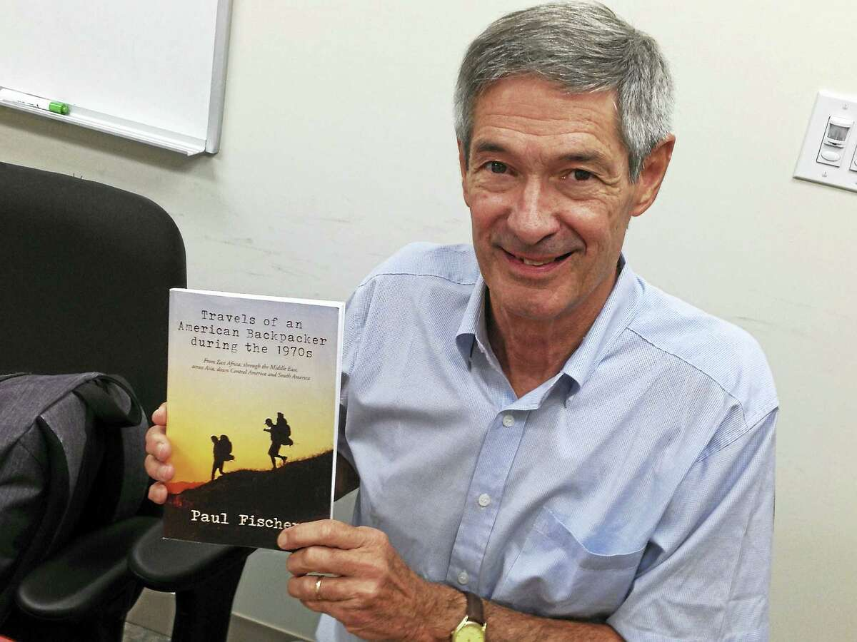 """Expatriate native West Havener Paul Fischer, now living in Chile, with a copy of his new book, """"Travels of an American Backpacking During the 1970s."""""""