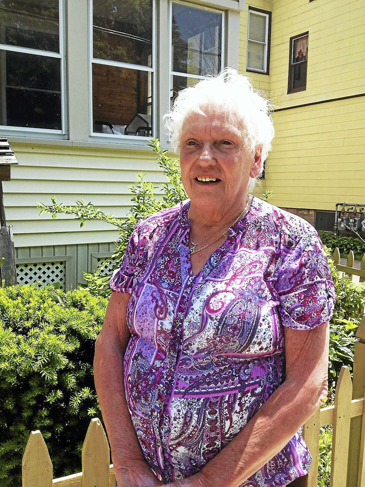 Frances Goekler-Morneau, outside her Fair Haven home, is among those who are objecting to use of a lot on Front Street in New Haven for boat storage.