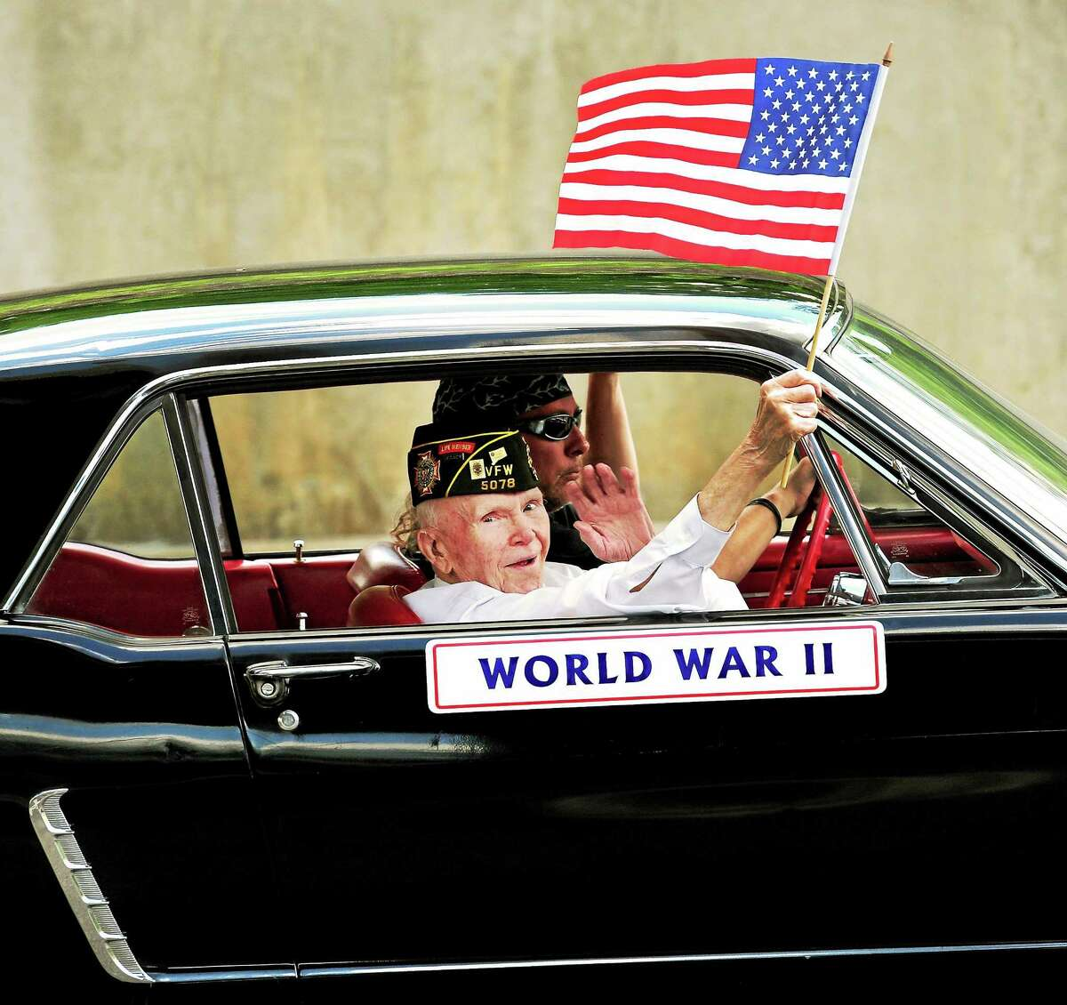 Walter March of Seymour, 95, a WWII Navy veteran, is driven up Main Street during the 2014 Memorial Day Parade.