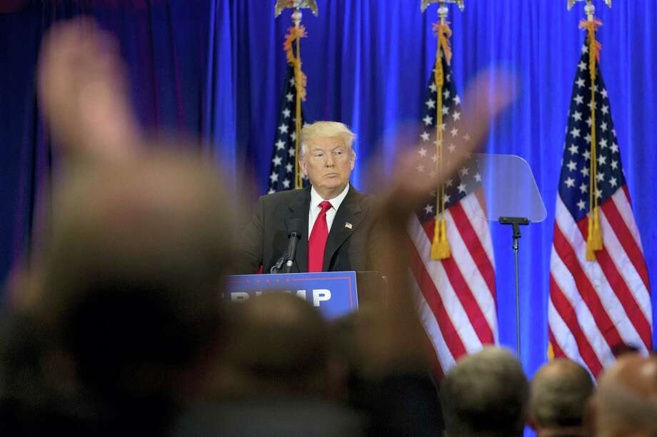 A supporter claps as Republican presidential candidate Donald Trump speaks in New York. Photo: AP Photo — Mary Altaffer / Copyright 2016 The Associated Press. All rights reserved. This material may not be published, broadcast, rewritten or redistribu