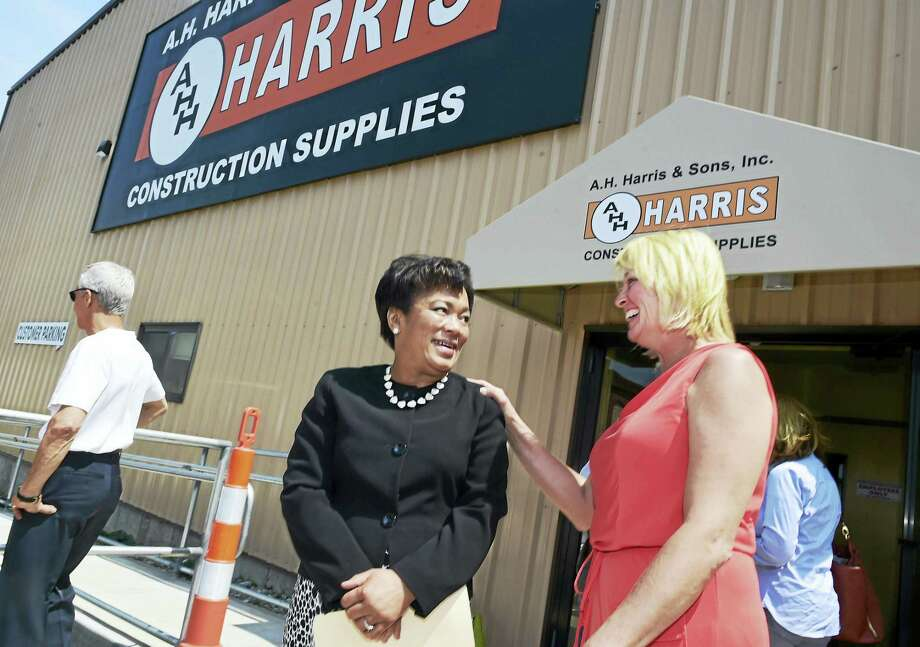 New Haven Mayor Toni N. Harp, left, and Kim J. Corwin, president and CEO of A.H. Harris Construction Supplies at the opening of its new building on Wheeler Street in New Haven Thursday. Photo: Peter Hvizdak — New Haven Register   / ?2016 Peter Hvizdak