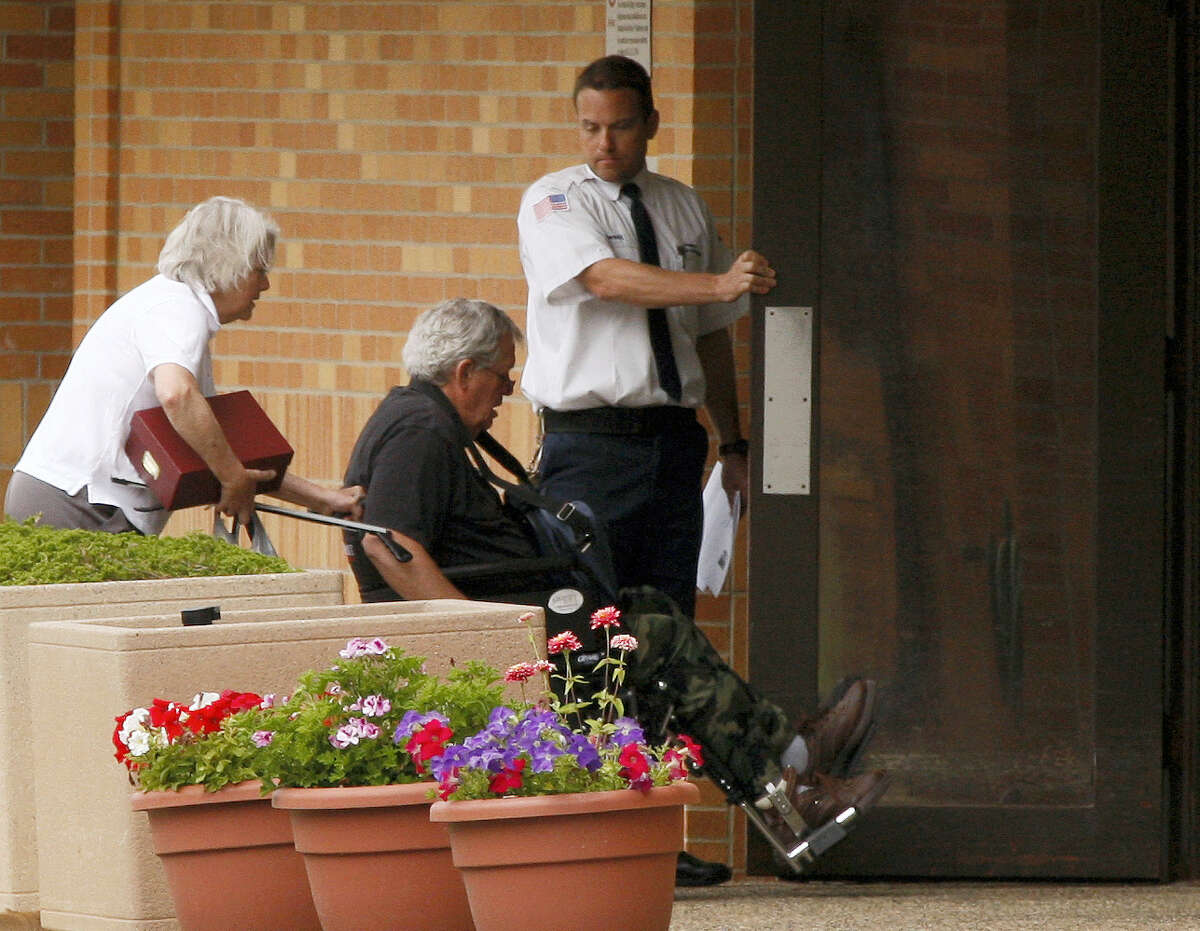 Former Speaker of the House Dennis Hastert, middle, reports to the Federal Medical Center in Rochester, Minn., on Wednesday, June 22, 2016, in a to serve a 15-month sentence.