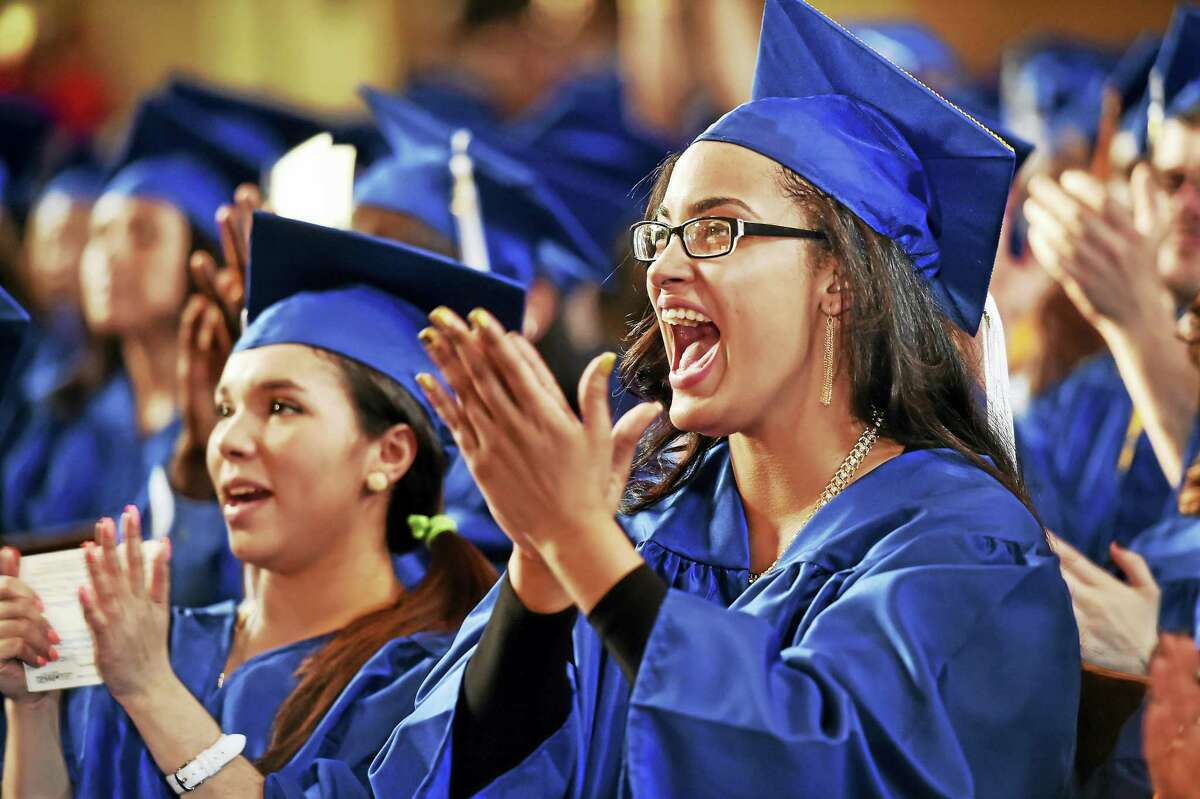 Margarita Celon-Sanchez of New Haven, right, and Melissa Parkes of Wallingford were among Gateway Community College graduate receiving degrees Thursday at Yale University's Woosley Hall in New Haven.