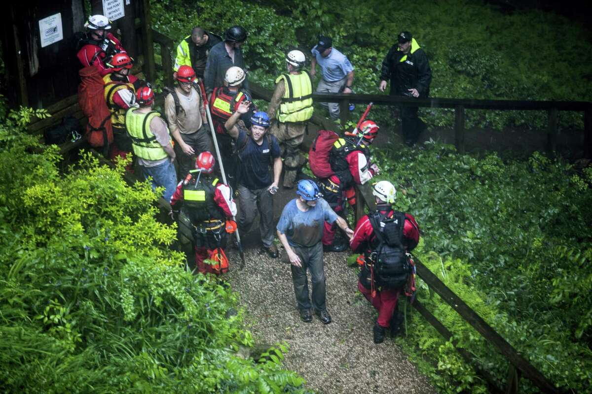 People who were rescued from Hidden River Cave exit the cave on Thursday, May 26, 2106, after 18 people on a cave tour were trapped due to flash flood waters in Horse Cave, Kentucky.