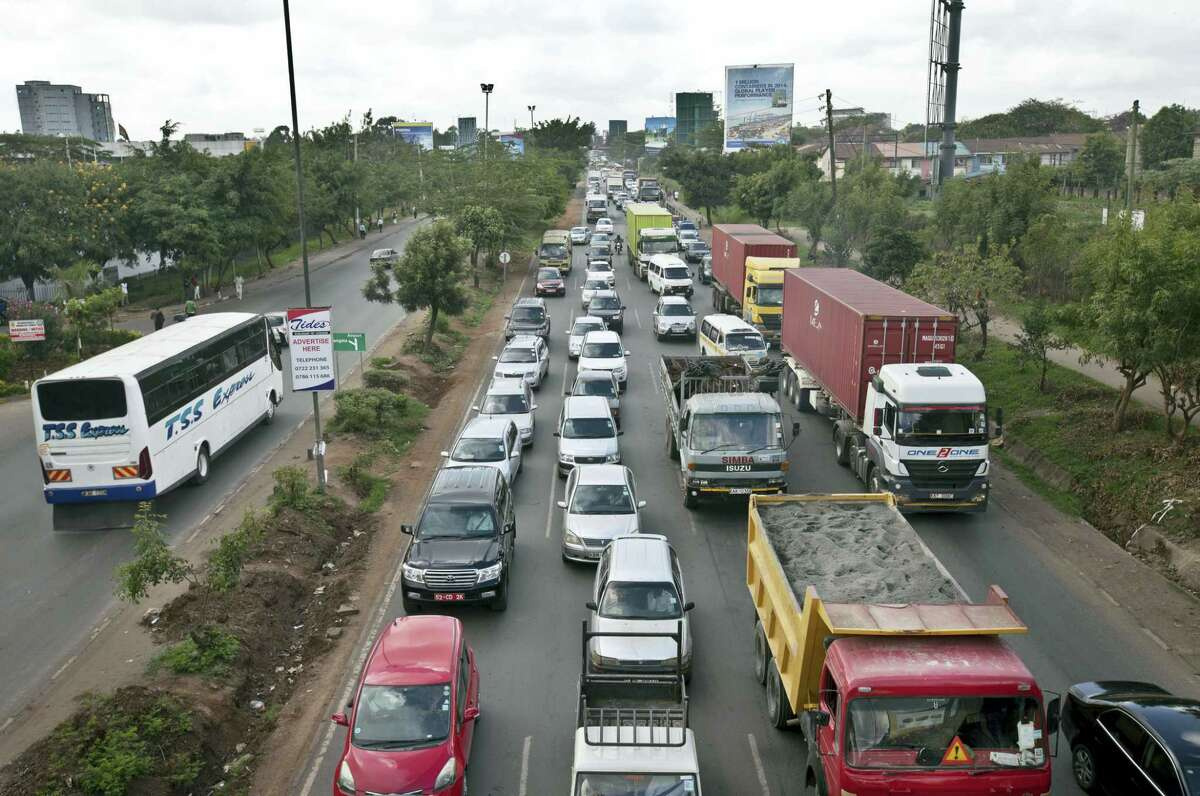 In this April 14, 2015 photo, drivers sit in queues of traffic on a highway in downtown Nairobi, Kenya during protest against Uber taxis. The ride-hailing Uber company said in Johannesburg on May 26, 2016 that it plans to start operating in the capitals of Ghana, Uganda and Tanzania withing a month.