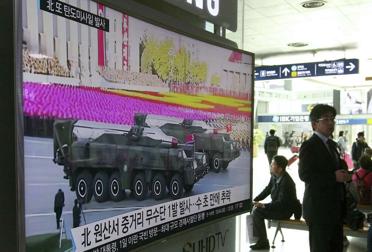 """A man walks by a TV news program showing a file footage of North Korean missiles paraded at a military parade in Pyongyang, at Seoul Railway Station in Seoul, South Korea, Thursday, April 28, 2016. A suspected powerful intermediate-range North Korean missile crashed moments after liftoff Thursday, South Korea's Defense Ministry said, in what would be the second such embarrassing failure in recent weeks. The letters on a screen read: """"North Korean launch of a Musudan missile appears to have failed."""""""