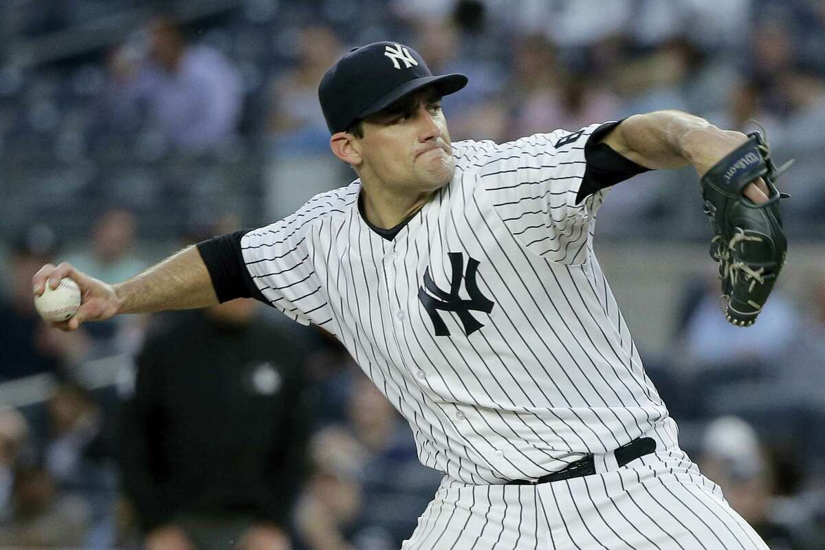 JULIE JACOBSON - THE ASSOCIATED PRESS New York Yankees pitcher Nathan Eovaldi delivers against the Toronto Blue Jays during the first inning Tuesday.