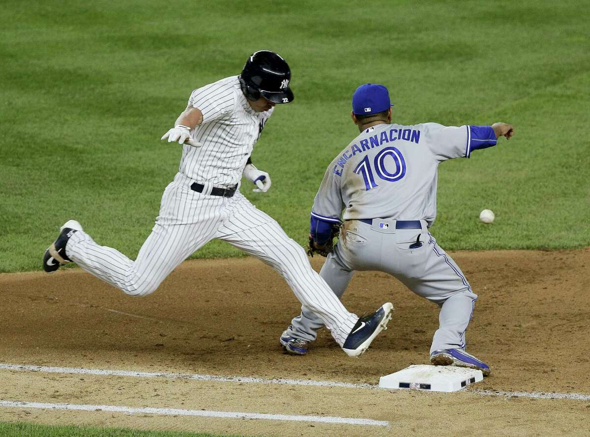JULIE JACOBSON - THE ASSOCIATED PRESS New York Yankees' Jacoby Ellsbury beats out the throw to Toronto Blue Jays first baseman Edwin Encarnacion on a ground ball hit to short during the seventh inning Tuesday in New York. Didi Gregorius scored on the play.