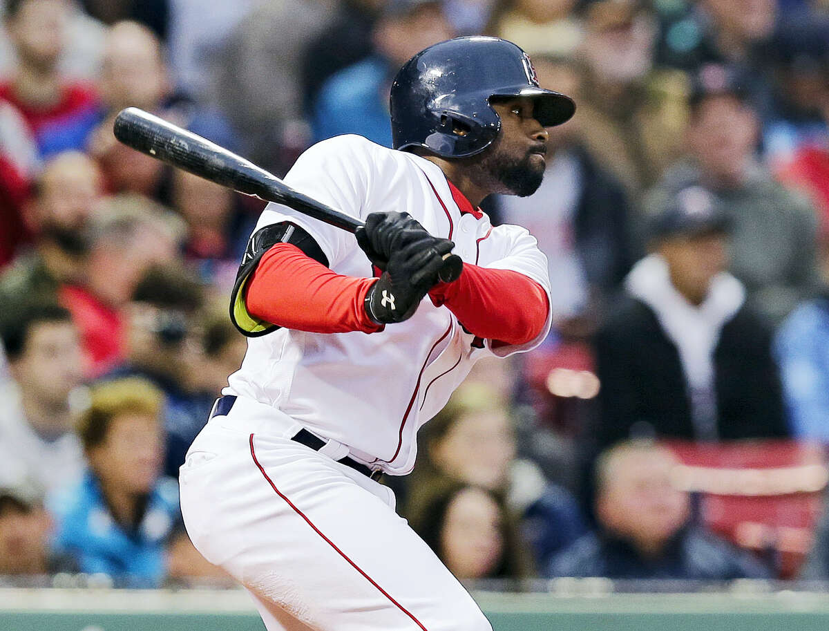 CHARLES KRUPA - THE ASSOCIATED PRESS Boston Red Sox's Jackie Bradley Jr. follows through on a double during the second inning of a baseball game against the Colorado Rockies in Boston. Bradley extended his hitting streak to 28 games.