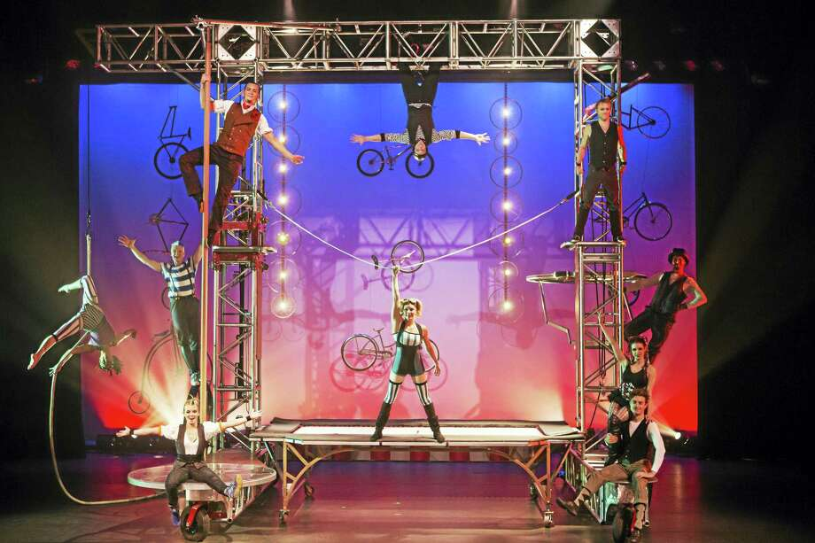 Members of Cirque Mechanics and the big Gantry Bike. Photo: Photo Courtesy Of Cirque Mechanics   / Photo by Zach Mahone