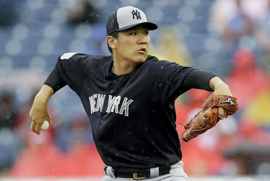 New York Yankees starting pitcher Masahiro Tanaka, seen here pitching against the Phillies Tuesday, will be the Yankees pitcher on opening day Monday. Photo: The Associated Press   / AP