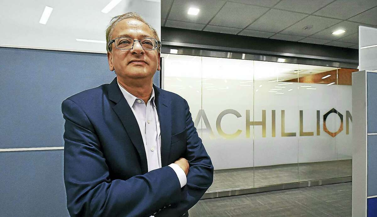 Milind Deshpande, CEO of Achillion Pharmaceuticals, is photographed Wednesday at their newly expanded headquarters, occupying 5,500 square feet, the entire ground floor at 300 George St. in New Haven.