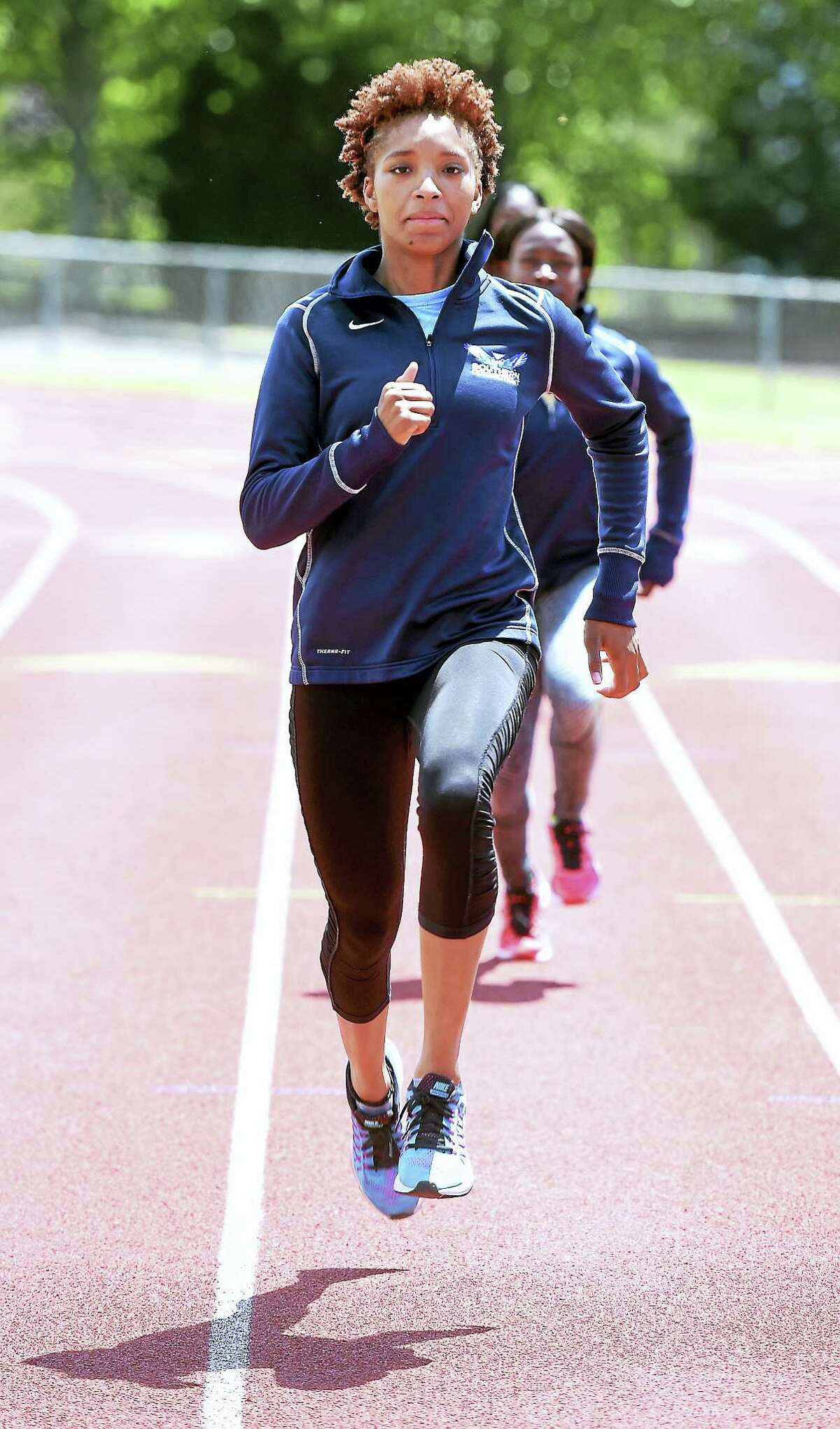Sprinter Shatajah Wattely practices at Southern Connecticut State University in preparation for the NCAA Division II Outdoor Track and Field Championships.