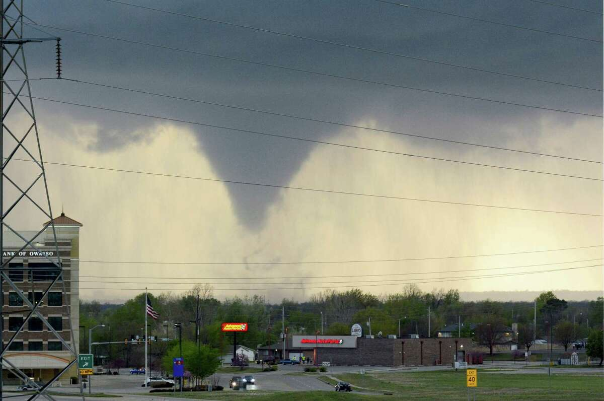 A tornado touches down in Tulsa, Okla., on Wednesday, March 30, 2016. The National Weather Service is confirming multiple tornado touchdowns in the Tulsa area.