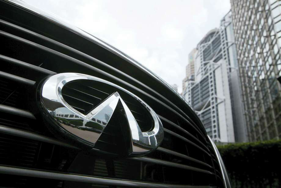 The Nissan Infiniti logo on a vehicle on display at the opening ceremony for an office in Hong Kong. Nissan announced June 22, 2016, the company is recalling more than 28,000 Infiniti luxury SUVs because the electronic steering can malfunction and bring the steering wheel to rest at an off-center position. Photo: AP Photo/Kin Cheung, File   / AP2012