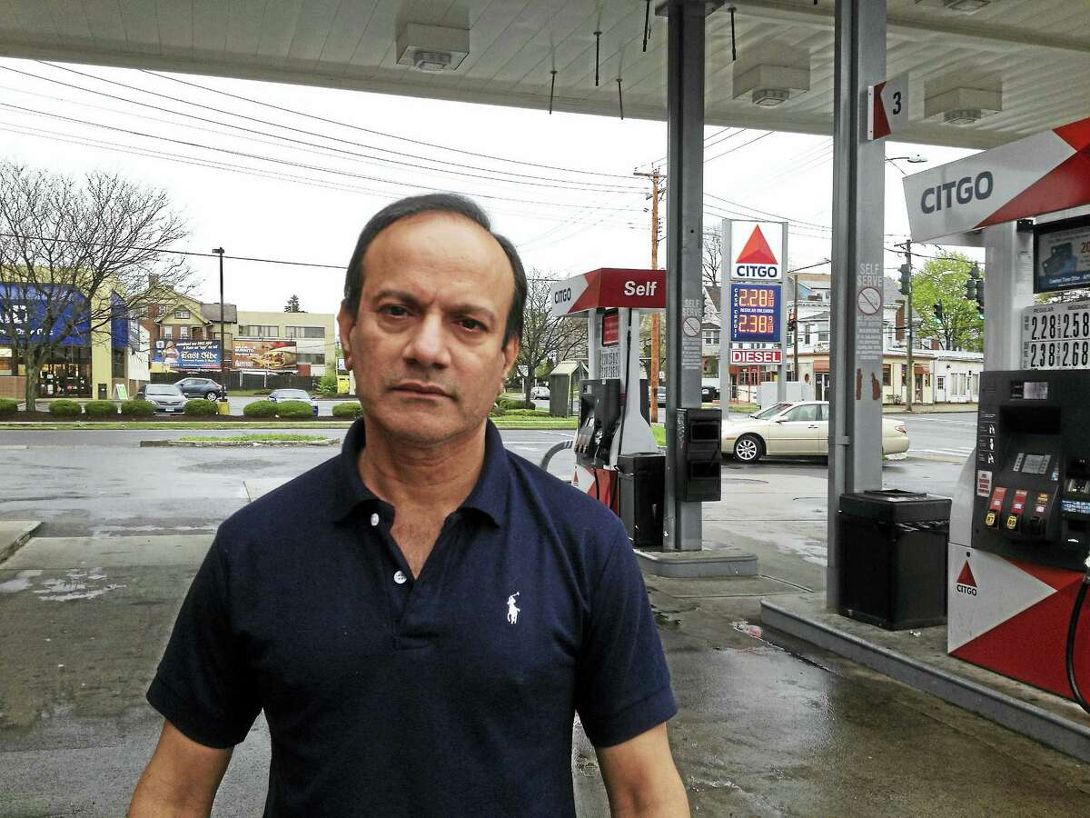 Saed Ahmed, co-owner of S & S Mini Mart Citgo at Elm Street and First Avenue in West Haven, standing outside his station.