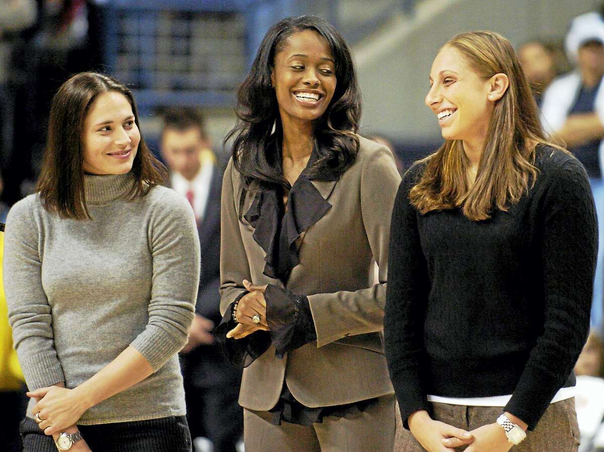 Former University of Connecticut women's basketball players Sue Bird, left, Swin Cash, center, and Diana Taurasi, seen here in 2006 sharing a light moment during the Huskies of Honor induction ceremony at Gampel Pavillion, were named three of the WNBA's Top 20 all-time players.