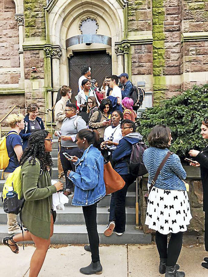 Students wait outside Battell Chapel before a forum about Yale University's college-naming announcements. Photo: ED STANNARD — NEW HAVEN REGISTER
